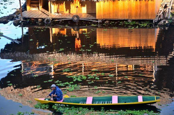 Man sitting in a canoe in Iquitos, Peru.